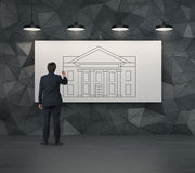 Businessman drawing bank Stock Image