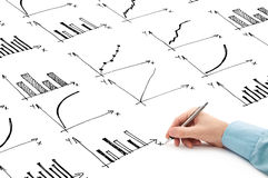 Businessman drawing bar chart and other infographics in note pad Royalty Free Stock Photos