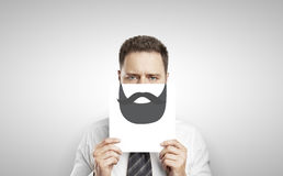 Businessman with drawing beard Stock Photo