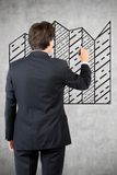 Businessman drawing black graphic Royalty Free Stock Photography