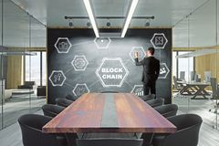 Businessman drawing blockchain sketch. Businessman drawing creative blockchain sketch in modern meeting room. Cryptocurrency concept. 3D Rendering stock photos
