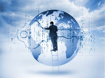 Businessman drawing a blue key with matrix and a planet Royalty Free Stock Photography