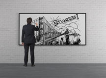 Businessman drawing bridge Royalty Free Stock Photography