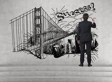 Businessman drawing bridge Stock Image