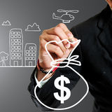Businessman drawing budget. Concept for show case something Stock Images