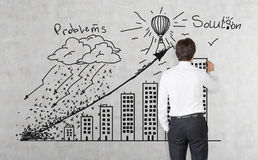 Businessman drawing building graph Stock Image