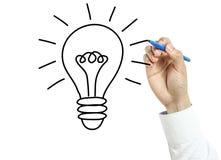 Businessman drawing bulb idea concept Stock Images