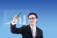 Businessman drawing business chart Royalty Free Stock Photo