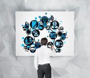 Businessman drawing business icon Royalty Free Stock Photos