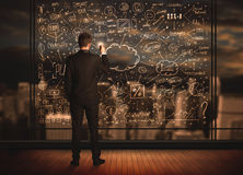 Businessman drawing business plan Stock Images