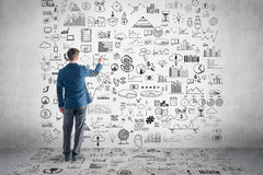 Businessman drawing business plan, graph, chart Stock Photo