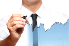 Businessman drawing a chart royalty free stock photo