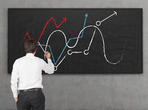 Businessman drawing chart Stock Photos