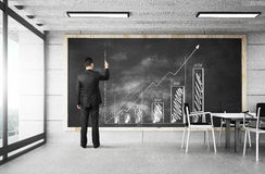 Businessman drawing chart Royalty Free Stock Image