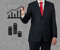 Businessman drawing chart Stock Photo