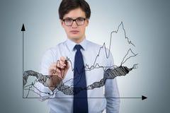 Businessman drawing chart Stock Image