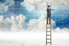 The businessman drawing charts in the sky Stock Photo