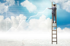 The businessman drawing charts in the sky Royalty Free Stock Photography
