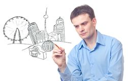 Businessman drawing a city Stock Photo