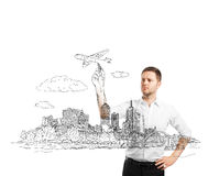 Businessman drawing city Royalty Free Stock Photo
