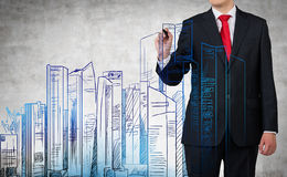 Businessman drawing city Stock Photography