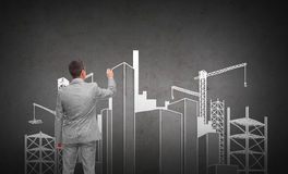 Businessman drawing city construction site Royalty Free Stock Images