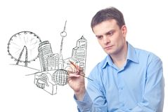 Businessman drawing a city of the future Royalty Free Stock Photos
