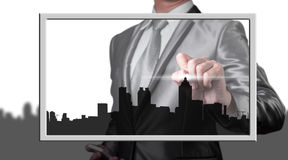 Businessman drawing city line Stock Images