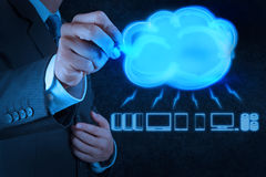 Businessman drawing a Cloud Computing diagram on the new compute Stock Photography