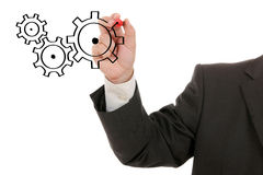 Businessman drawing cogwheels Stock Photos
