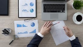 Businessman drawing components of startup plan, brainstorm and ideas, top view royalty free stock photo