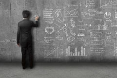 Businessman drawing concept and strategy on wall Royalty Free Stock Photos