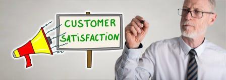 Businessman drawing customer satisfaction concept. Customer satisfaction concept drawn by a businessman Stock Image