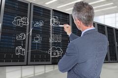 Businessman drawing in a data center. Digital composite of data center with model royalty free stock photography