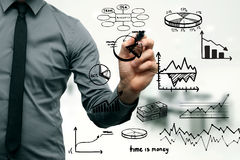 Businessman drawing different graphs and chartss Stock Image