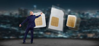 Businessman drawing different size of a smartphone sim card 3d r. View of a Businessman drawing different size of a smartphone sim card 3d rendering Royalty Free Stock Photography