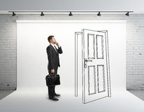 Businessman and drawing door Stock Image