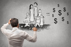 Businessman drawing a family. Businessman drawing a happy family Royalty Free Stock Photo