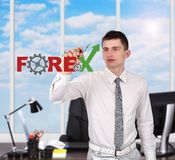 Businessman drawing forex symbol Royalty Free Stock Images