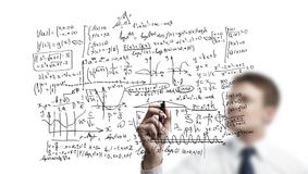 Businessman drawing formulas. Businessman drawing mathematical formulas on a board Stock Photo