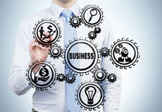 Businessman drawing gears Royalty Free Stock Images