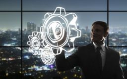 Businessman drawing gears Stock Photography
