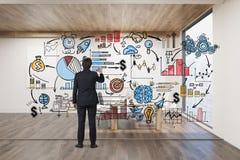 Businessman drawing on glassboard Stock Photos