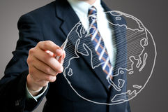 Businessman drawing  Global Stock Photo