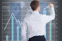 Businessman drawing a graph  on a big touchscreen Stock Images