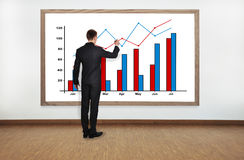 Businessman drawing graph Stock Photo