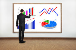 Businessman drawing graph Stock Photos