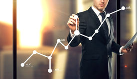 Businessman drawing graph Royalty Free Stock Photo