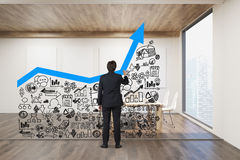 Businessman drawing graph on glassboard Royalty Free Stock Images