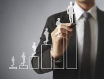 Businessman drawing graphics  growing graph Royalty Free Stock Photo